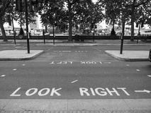 Look right, look left sign in London black and white. LONDON, UK - CIRCA JUNE 2017: look right and look left road signs in black and white Royalty Free Stock Photography