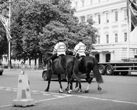 Police on horseback in London black and white