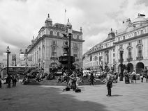 People in Piccadilly Circus in London black and white Stock Image