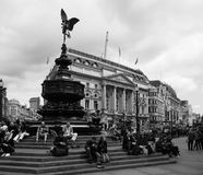People in Piccadilly Circus in London black and white Stock Photo