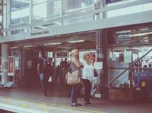 Tottenham Hale station in London, vintage look. LONDON, UK - CIRCA JUNE 2016: People waiting for transport at Tottenham Hale station platform, vintage looking Stock Photo