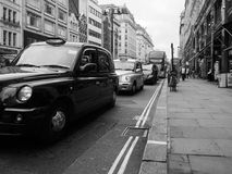Taxi cab in London black and white. LONDON, UK - CIRCA JUNE 2017: Taxi cabs in the city centre in black and white stock photography