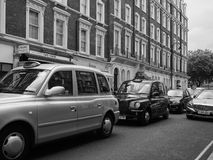 Taxi cab in London black and white. LONDON, UK - CIRCA JUNE 2017: Taxi cabs in the city centre in black and white royalty free stock photo