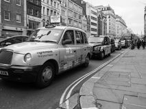 Taxi cab in London black and white. LONDON, UK - CIRCA JUNE 2017: Taxi cabs in the city centre in black and white stock photo