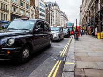Taxi cab in London, hdr. LONDON, UK - CIRCA JUNE 2017: Taxi cabs in the city centre, high dynamic range Stock Image