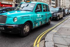 Taxi cab in London (hdr). LONDON, UK - CIRCA JUNE 2017: Taxi cabs in the city centre (high dynamic range Royalty Free Stock Image
