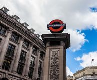 Tube station in London, hdr. LONDON, UK - CIRCA JUNE 2017: tube station roundel sign, high dynamic range Royalty Free Stock Images