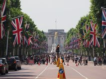 The Mall in London. LONDON, UK - CIRCA JUNE 2018: Union Jack flags on the Mall for the celebration of the Queen birthday with Buckingham Palace in the background Royalty Free Stock Images