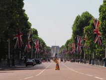 The Mall in London. LONDON, UK - CIRCA JUNE 2018: Union Jack flags on the Mall for the celebration of the Queen birthday with Buckingham Palace in the background Royalty Free Stock Photo