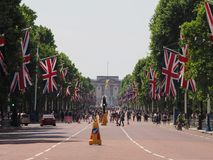 The Mall in London. LONDON, UK - CIRCA JUNE 2018: Union Jack flags on the Mall for the celebration of the Queen birthday with Buckingham Palace in the background Royalty Free Stock Photography