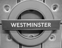 Westminster tube station roundel in London black and white. LONDON, UK - CIRCA JUNE 2017: Westminster tube station roundel in black and white Stock Photo
