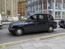Black taxi cab. LONDON, UK - CIRCA NOVEMBER 2009: Black taxi cab in a street of the city centre stock photos