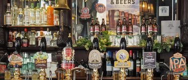 Cask beers in London. LONDON, UK - CIRCA SEPTEMBER 2015: Draught cask beers in a traditional English Pub stock images