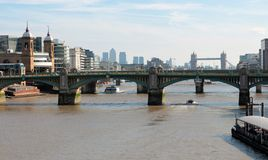London UK - city landscape. A view of London, UK with bridges over Thames river; Far, far away, Tower Bridge is visible and London sky scrapers stock image