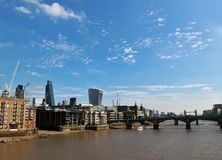 London UK - city landscape. A view of London, UK with bridges over Thames river; Far, far away, Tower Bridge is visible and London sky scrapers Royalty Free Stock Photo