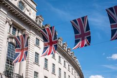 Close up of building on Regent Street London with row of British flags to celebrate the wedding of Prince Harry to Meghan Markle royalty free stock photos