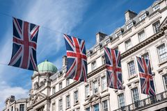 Close up of building on Regent Street London with row of British flags to celebrate the wedding of Prince Harry to Meghan Markle. London UK. Close up of building royalty free stock image