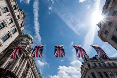 Close up of building on Regent Street London with row of British flags to celebrate the wedding of Prince Harry to Meghan Markle royalty free stock photo