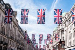 Close up of buildings on Regent Street London with row of British flags to celebrate the wedding of Prince Harry to Meghan Markle stock images