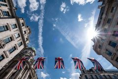 Close up of buildings on Regent Street London with row of British flags to celebrate the wedding of Prince Harry to Meghan Markle Royalty Free Stock Photos