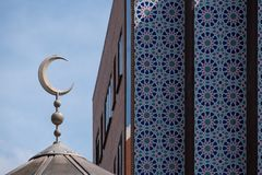 Close up of the dome of the East London Mosque on Whitechapel Road, with the decorative mosaic tiles of the London Muslim Centre stock image