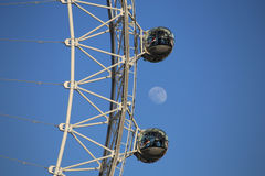 London, UK. 04.20.2016. A close-up view of the London Eye with the moon in the background. Stock Photography