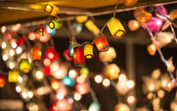 Christmas lights decorations at Southwark open market in London. Christmas background. London, UK - December 19, 2015: Christmas lights decorations at Southwark royalty free stock image