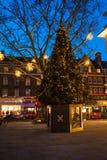 Decorated Christmas tree on Duke of York Square in London UK. LONDON, UK - DECEMBER 09, 2017: Decorated Christmas tree on Duke of York Square just off the stock photos