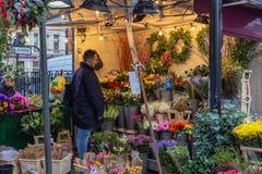 London, UK - 20, December 2018: Flower stalls in Camden Lock Market or Camden Town in London, England, United Kingdom royalty free stock image