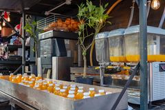 London, UK - 20, December 2018: Natural fruit juice stand in Camden Lock Market or Camden Town in London, England, United Kingdom royalty free stock photos