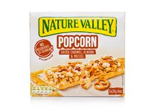 LONDON, UK - DECEMBER 01, 2017: Nature Valley crunchy granola bars with caramel almond and pretzel in a box with on white. Nature. LONDON, UK - DECEMBER 01, 2017 royalty free stock photo