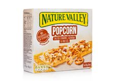 LONDON, UK - DECEMBER 01, 2017: Nature Valley crunchy granola bars with caramel almond and pretzel in a box with on white. Nature. LONDON, UK - DECEMBER 01, 2017 stock images