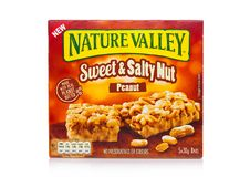 LONDON, UK - DECEMBER 01, 2017: Nature Valley crunchy granola bars with peanut in a box with on white. Nature Valley is a General. LONDON, UK - DECEMBER 01, 2017 royalty free stock images
