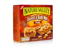 LONDON, UK - DECEMBER 01, 2017: Nature Valley crunchy granola bars with peanut in a box with on white. Nature Valley is a General. LONDON, UK - DECEMBER 01, 2017 stock photo