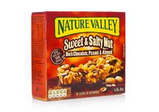 LONDON, UK - DECEMBER 01, 2017: Nature Valley crunchy granola bars with peanut and caramel in a box with on white. Nature Valley i. LONDON, UK - DECEMBER 01 stock photography