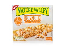 LONDON, UK - DECEMBER 01, 2017: Nature Valley crunchy granola bars with peanut and sunflower in a box with on white. Nature Valley. LONDON, UK - DECEMBER 01 stock photography