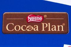 Nestle Cocoa Plan. LONDON, UK - DECEMBER 18TH 2017: A close-up of the Nestle Cocoa Plan symbol on a Crunch chocolate bar, on 18th December 2017.  The plan aims Royalty Free Stock Photo
