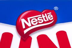 Nestle Company Logo. LONDON, UK - DECEMBER 18TH 2017: A close-up of the Nestle company logo, on 18th December 2017.  Nestle is a Swiss food and drink company Stock Photos