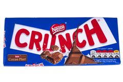 Crunch Bar by Nestle. LONDON, UK - DECEMBER 18TH 2017: A Crunch chocolate bar, manufactured by Nestle, over a plain white background, on 18th December 2017 Royalty Free Stock Photography
