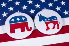 Republicans and Democrats. LONDON, UK - DECEMBER 18TH 2017: The Elephant symbol of the Republican Party and the Donkey symbol of the Democratic Party, with the Royalty Free Stock Photo