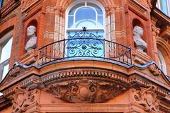 LONDON, UK: Details of red brick Victorian houses facades in the borough of Westminster Royalty Free Stock Photography