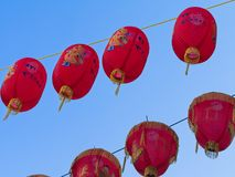 Close-up of Chinese red lanterns for the Chinese New Year against blue sky background. stock photography
