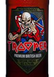 LONDON, UK - FEBRUARY 14, 2018: Cold Bottle label of Trooper Premium British Beer on white. Created by Iron Maiden. Stock Photography