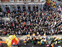 LONDON, UK - 14 FEBRUARY 2016: Crowd for for Chinese New Year 2016 'Year of the Monkey' parade. Participants in parade on edges o. LONDON, UK - 14 FEBRUARY 2016 royalty free stock images