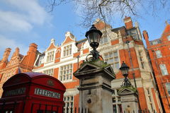 LONDON, UK - FEBRUARY 13, 2017: The entrance of Mount Street Gardens borough of Westminster with Red brick Victorian houses faca Stock Photos