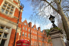 LONDON, UK - FEBRUARY 13, 2017: The entrance of Mount Street Gardens borough of Westminster with Red brick Victorian houses faca Royalty Free Stock Images