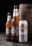 LONDON, UK - FEBRUARY 06, 2019: Glass bottle and aluminium can of San Miguel lager beer next to wooden barrel. The San Miguel brand of beer is the leading royalty free stock photos