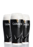 LONDON, UK - FEBRUARY 26, 2017: Glasses of Guinness original beer on white background. Guinness beer has been produced since 1759 Stock Images
