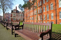LONDON, UK - FEBRUARY 13, 2017: Mount Street Gardens with Red brick Victorian houses facades in the borough of Westminster. Mount Street Gardens with Red brick royalty free stock image