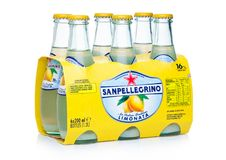 LONDON, UK - FEBRUARY 14, 2018: Pack of Glass bottles of Sanpellegrino Limonata soft drink with lemon flavor on white. LONDON, UK - FEBRUARY 14, 2018: Pack of stock photo